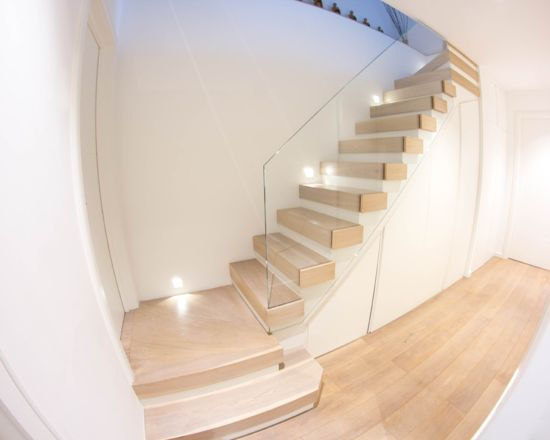 spiral stairs with glass balustrade
